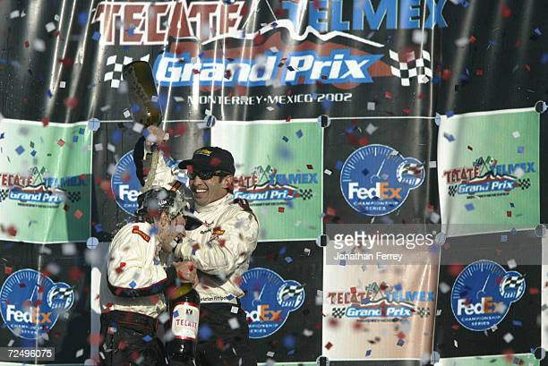 Race victor Cristiano da Matta and Newman Haas Racing third placed teammate Christian Fittipaldi celebrate on the podium atduring the Tecate Telmex...