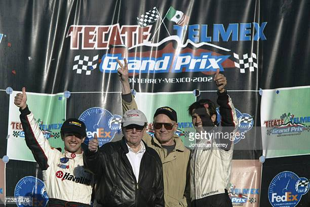 Race victor Cristiano da Matta (left0 celebrates with team owners Carl Haas, Paul Newman and third placed teammate Christian Fittipaldi on the podium...