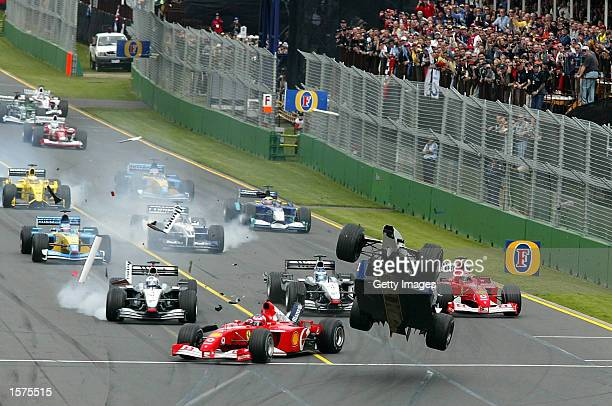 Ralf Schumacher of Germany and BMW Williams gets airborne after clipping the back of Ruben Barrichello's Ferrari at start of the 2002 Fosters...