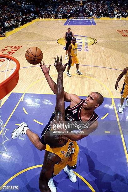 Richard Jefferson of the New Jersey Nets drives to the basket against Shaquille O''Neal of the Los Angeles Lakers during the NBA game at Staples...