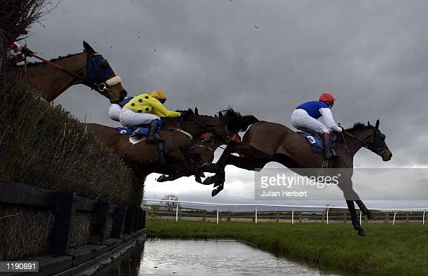 Richard Johnson and Dads Lad clear the water jump at Bangor On Dee before landing The Cloy Novices Handicap Steeple Chase DIGITAL IMAGE Mandatory...