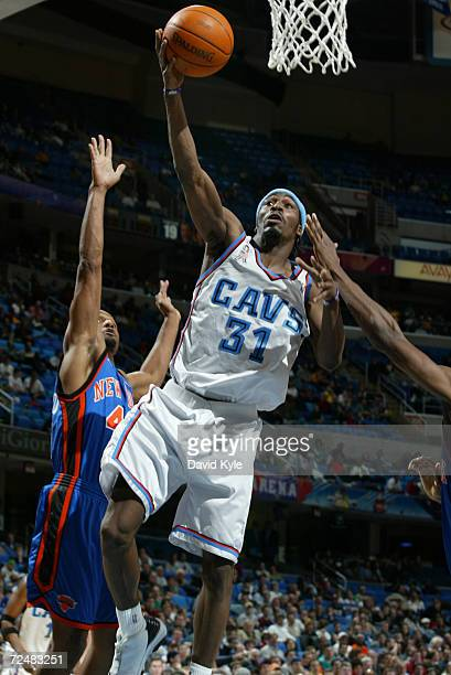 Ricky Davis of the Cleveland Cavaliers drives to the basket against Kurt Thomas of the New York Knicks at the Gund Arena in Cleveland Ohio DIGITAL...