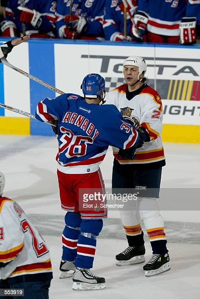 Rocky Thompson of the Florida Panthers challenges Matthew Barnaby of the New York Rangers during the game at National Car Rental Center in Sunrise...