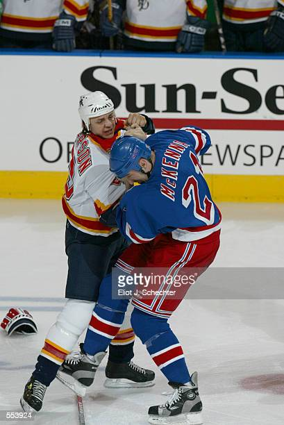 Rocky Thompson of the Florida Panthers exchanges punches with Steve McKenna of the New York Rangers during the game at National Car Rental Center in...