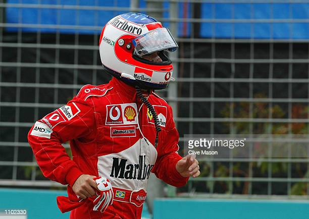 Rubens Barichello of Brazil and Ferrari runs back to the pits after an incident on turn one the 2002 Fosters Australian Grand Prix at the Albert Park...