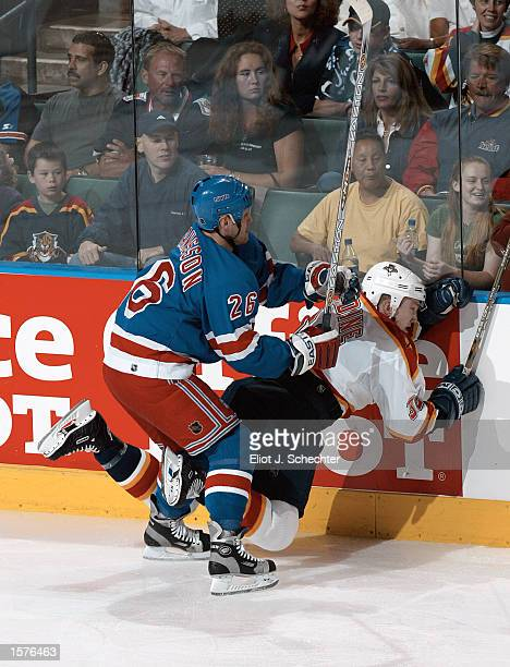 Ryan Jardine of the Florida Panthers is tripped by Pierre Dagenais of the New York Rangers in the first period of NHL action at the National Car...