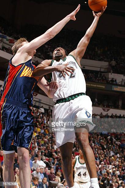 Sam Mitchell of the Minnesota Timberwolves with the one handed layup against Troy Murphy of the Golden State Warriors at Target Center in Minneapolis...