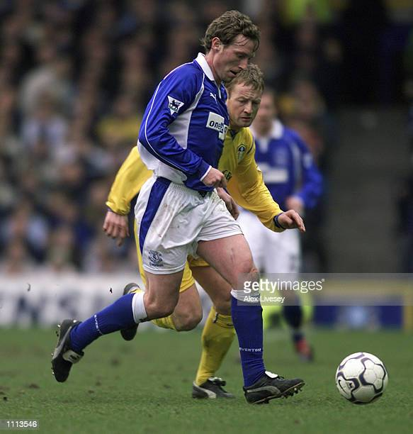 Scot Gemmill of Everton takes the ball past David Batty of Leeds United during the FA Barclaycard Premiership match played at Goodison Park in...