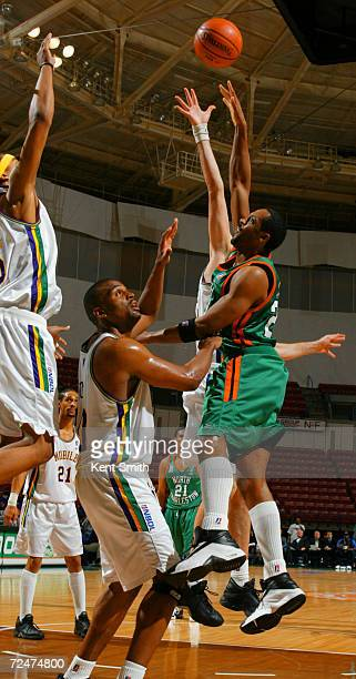 Sedric Webber of the North Charleston Lowgators drops a half hook shot over the top of the defense by Derek Hood of the Mobile Revelers at the North...