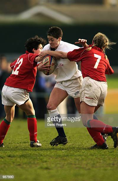 Shelley Rae of England is tackled by the Wales defence during the Womens International between England and Wales at Old Deer Park Richmond Surrey...