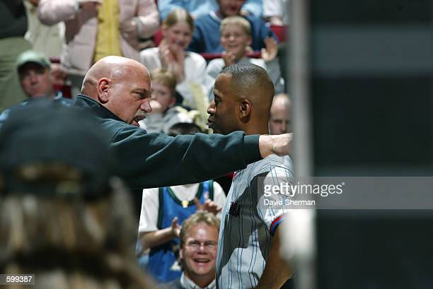 State governor and Minnesota Timberwolves fan Jesse Ventura yells at an official during the NBA game against the Dallas Mavericks at the Target...