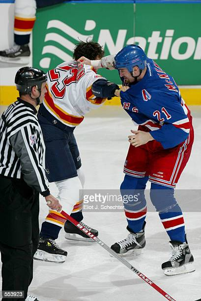 Steve McKenna of the New York Rangers grabs Rocky Thompson of the Florida Panthers during the game at National Car Rental Center in Sunrise Florida...