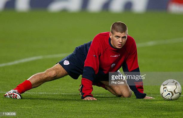 Steven Gerrard warms up during Liverpool training before tomorrow UEFA Champions League match against Barcelona at the Nou Camp Barcelona Spain...