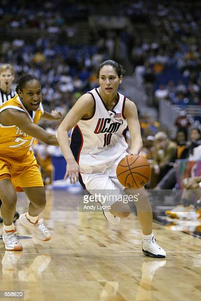 Sue Bird of Connecticut drives around Loree Moore of Tennessee during the NCAA Women's Final Four game at the Alamo Dome in San Antonio Texas...