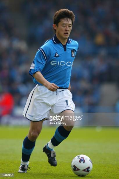 Sun Jihai of Manchester City runs with the ball during the Nationwide League Division One match between Manchester City and Nottingham Forest played...