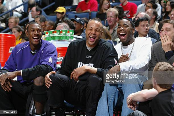 Teammates Chucky Brown, Lawrence Funderburke and Mateen Cleaves of the Sacramento Kings share a laugh on the bench during the game against the Golden...