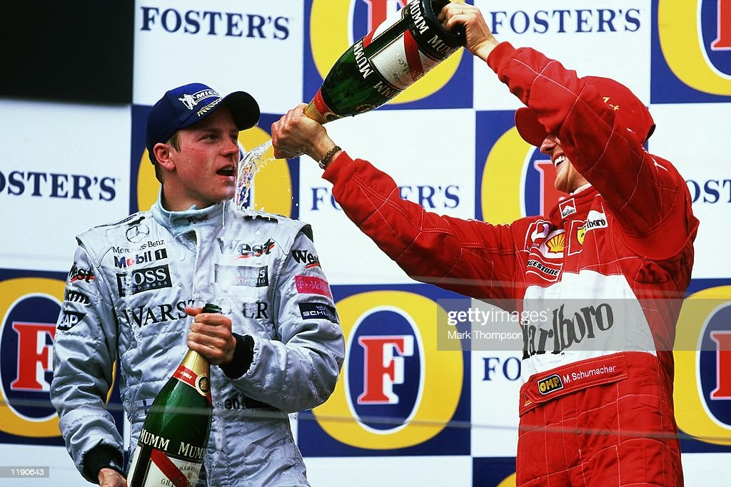 Kimi Raikkonen and Michael Schumacher : News Photo