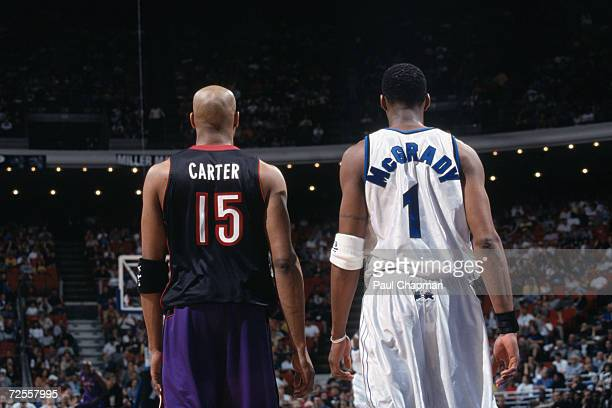 This is a close up of guard Vince Carter of the Toronto Raptors and guard Tracy McGrady of the Orlando Magic. The picture was taken during the NBA...