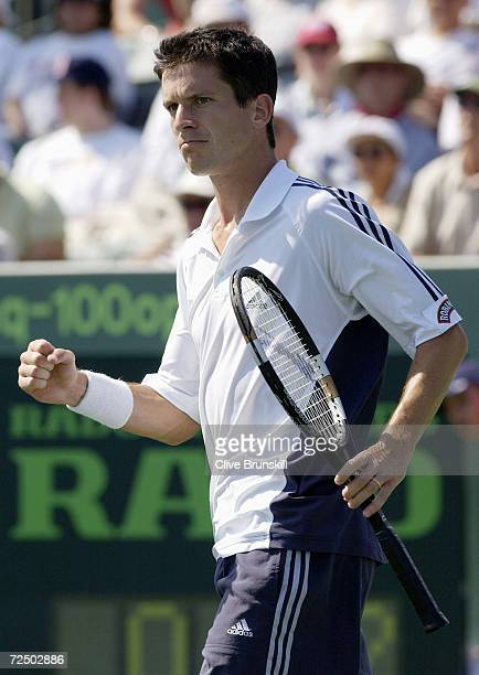 Tim Henman of Great Britain celebrates a point against Lars Burgsmuller of Germany during the Nasdaq100 Open at The Tennis Center at Crandon Park in...