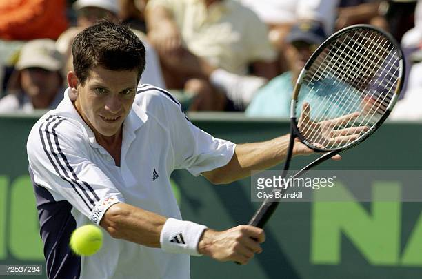 Tim Henman of Great Britain returns a shot to Lars Burgsmuller of Germany during the Nasdaq100 Open at The Tennis Center at Crandon Park in Miami...