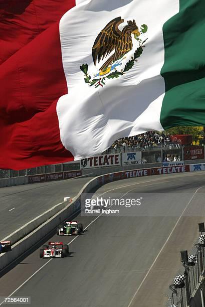 Toranosuke Takagi, or Tora Takagi of Japan holds off Mario Dominguez and Michael Andretti during the Tecate Telmex Grand Prix of Monterrey, round 1...