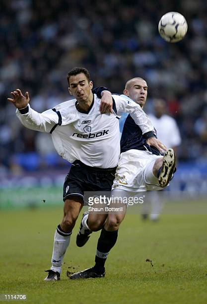 Youri Djorkaeff of Bolton Wanderers tries to take the ball past Danny Higginbotham of Derby County during the FA Barclaycard Premiership match played...