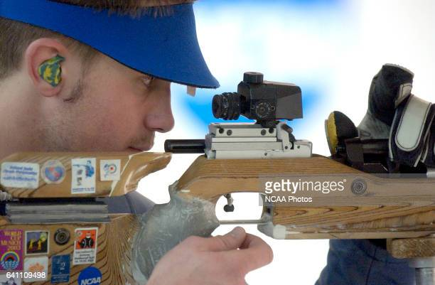 Matt Rawlings of Alaska Fairbanks loads his air rifle during the Division 1 Men's and Women's Rifle Championship held at the United States Olympic...