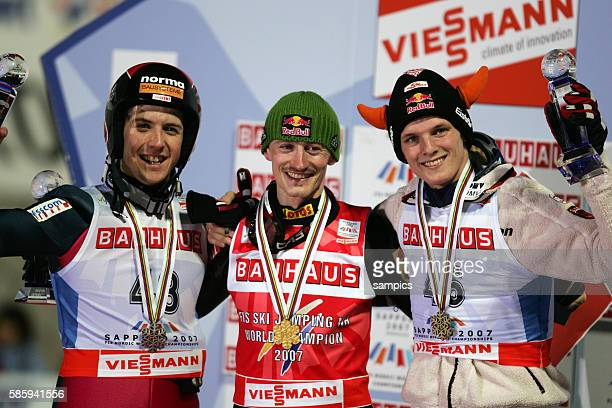 03 Mar 2007 Sapporo Japan ski jumping vlSimon Ammann world champion winner Adam Malysz POL and Thomas Morgenstern 2007 Nordic Ski World Championships...