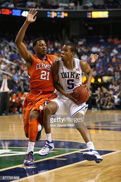 Duke Blue Devils forward Rodney Hood dribbles against Clemson Tigers guard Damarcus Harrison during the ACC Mens Basketball Tournament Championship...