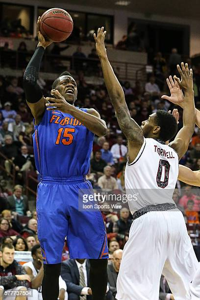 Florida Gators forward Will Yeguete puts up the shot over South Carolina Gamecocks guard Sindarius Thornwell during SEC basketball action at Colonial...