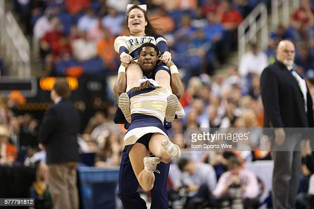 Pittsburgh Panthers cheerleaders do a human spin during the ACC Mens Basketball Tournament Championship at the Greensboro Coliseum Greensboro North...