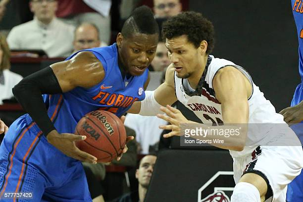 South Carolina Gamecocks forward Michael Carrera fights for the ball with Florida Gators forward Will Yeguete during SEC basketball action at...