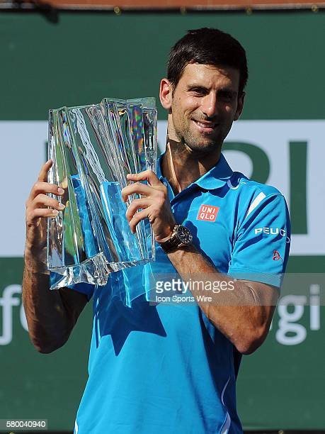 Novak Djokovic holds the winners trophy after Djokovic defeated Milos Raonic 6-2, 6-0 to become the 2016 BNP Paribas Open Champion in a tournament...