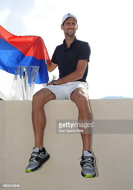 Novak Djokovic posses for photo with the winners trophy after Djokovic defeated Milos Raonic 6-2, 6-0 to become the 2016 BNP Paribas Open Champion in...