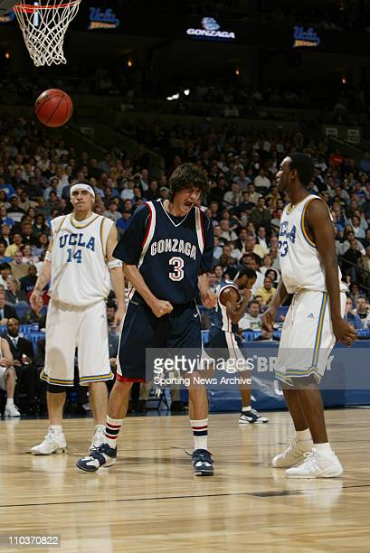 Mar 23 2006 Oakland CA USA NCAA Basketball The Gonzaga Bulldogs Adam Morrison against the UCLA Bruins Cedric Bozeman and Lorenzo Mata during...