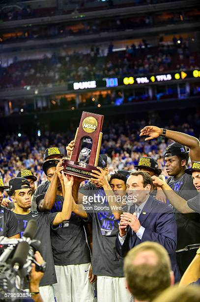 Mar 29, 2015- Houston, TX-- Duke players hoist the Regional Championship trophy as Coach K addresses the crowd following Regional play of the Elite...