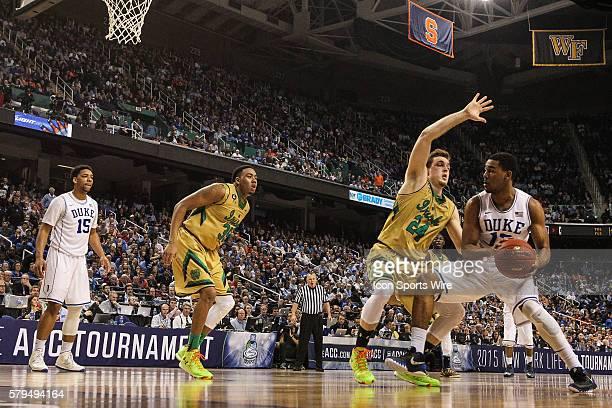 Duke Blue Devils guard Matt Jones works to the basket against Notre Dame Fighting Irish guard/forward Pat Connaughton during the ACC Tournament at...