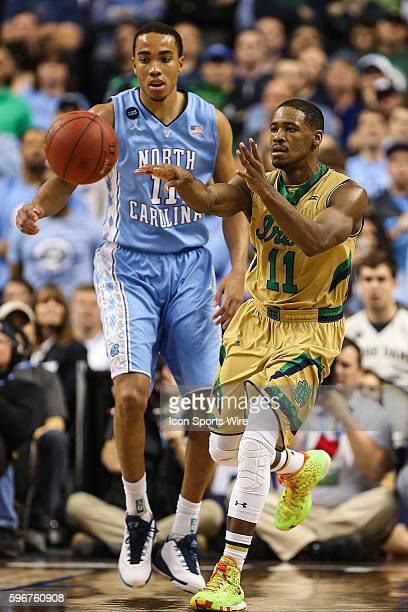 North Carolina Tar Heels forward Brice Johnson watches as Notre Dame Fighting Irish guard Demetrius Jackson passes off during the ACC Tournament...