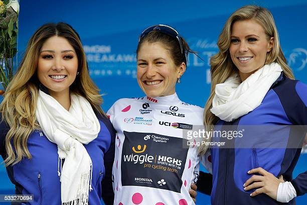 Mara Abbott of the United States riding for Wiggle High5 Pro Cycing takes the podium to receive the queen of the mountains polka dot jersey following...