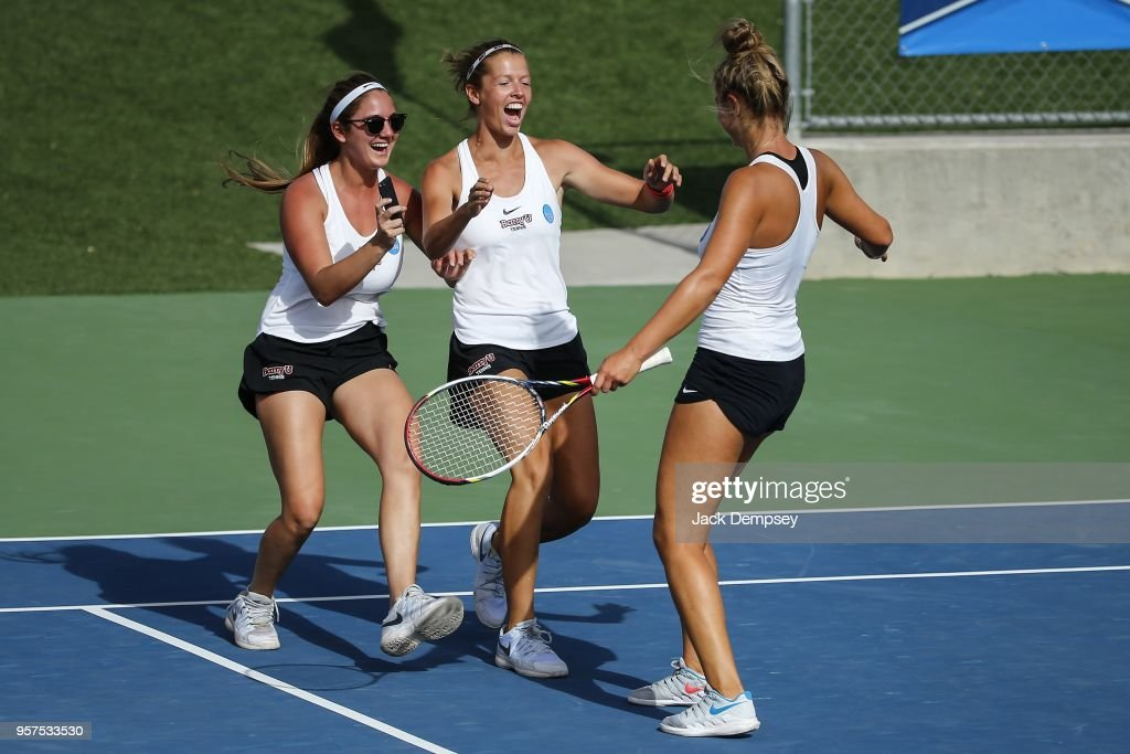 Mara Cerrini, left, and Judith Bohnenkamp rush to celebrate the team's win with Sonja Larsenr during the Division II Women's Tennis Championship held at the Surprise Tennis & Racquet Club on May 11, 2018 in Surprise, Arizona.