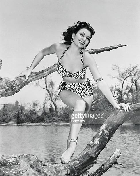 Mara Corday in a leopard swimsuit is a welcome sight down by the river side as she shows off a pair of matching bracelets one on her arm and one on...