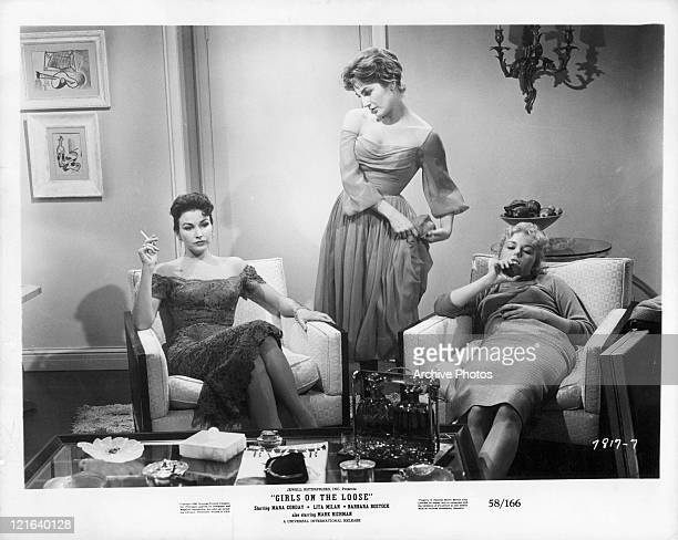 Mara Corday Lita Milan and unidentified actress sitting in room having conversation in a scene from the film 'Girls On The Loose' 1958