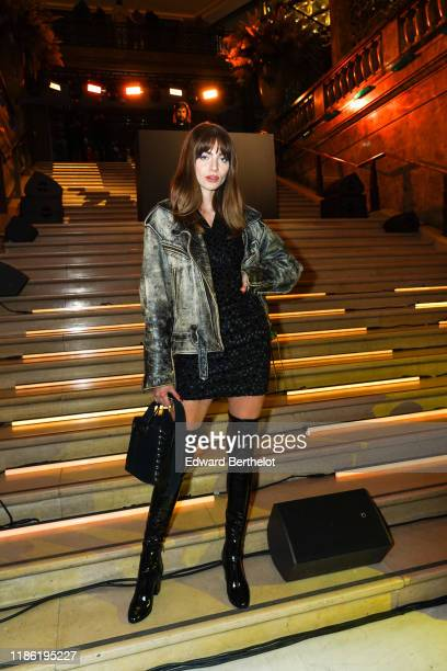 Mara Lafontan wears a leather jacket, a black sequined dress, black thigh high boots, a bag, during Moncler House Of Genius : Paris Opening Event at...