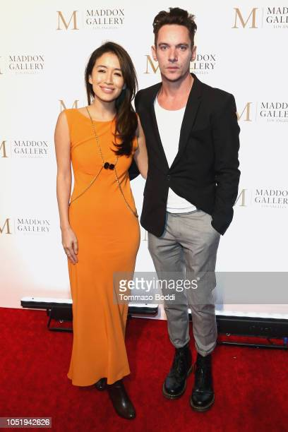Mara Lane and Jonathan Rhys Meyers attend the Grand Opening Maddox Gallery Los Angeles on October 11 2018 in West Hollywood California
