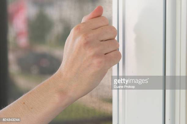 Mara Mulvihill knocks on a door while taking part in a MoveOnorg Neighborhood Listening Project Healthcare Door Knocking Canvass on July 29 2017 in...