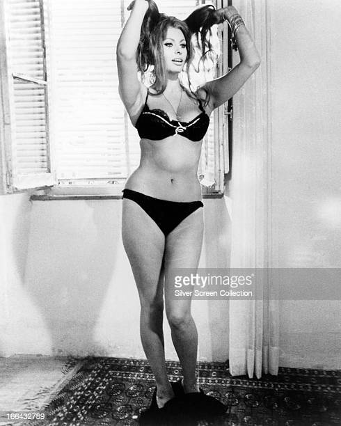 Mara played by Italian actress Sophia Loren performs a striptease in a scene from 'Yesterday Today And Tomorrow' directed by Vittorio de Sica Italy...