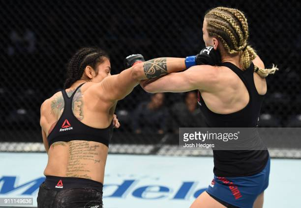 Mara Romero Borella of Italy punches Katlyn Chookagian in their women's flyweight bout during a UFC Fight Night event at Spectrum Center on January...