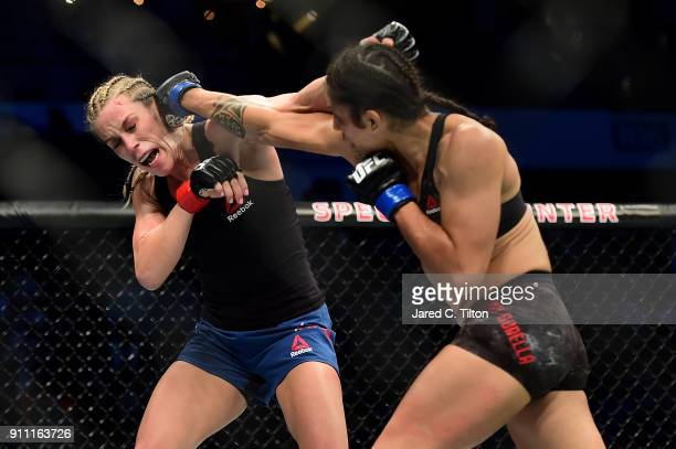 Mara Romero Borella of Italy punches Katlyn Chookagian in their flyweight bout during the UFC Fight Night event inside the Spectrum Center on January...