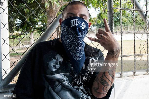 A Mara Salvatrucha gang member attends a press conference where leaders of the Mara Salvatrucha and Barrio 18 declared the city of Quezaltepeque a...