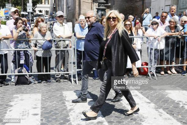 Mara Venier and Jerry Cala attend the funeral for Carlo Vanzina at Santa Maria degli Angeli on July 10 2018 in Rome Italy